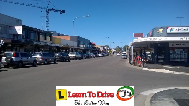 Busy street in St Marys from view of car during driving lesson